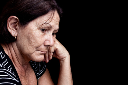 Sad and worried old woman